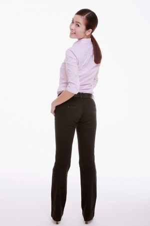 Businesswoman turning and looking over her shoulders photo