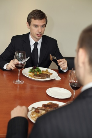 Businessmen having lunch at a restaurant Stock Photo - 13355055