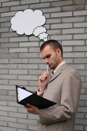 Businessman with thought bubble while writing in organizer Stock Photo - 13355279