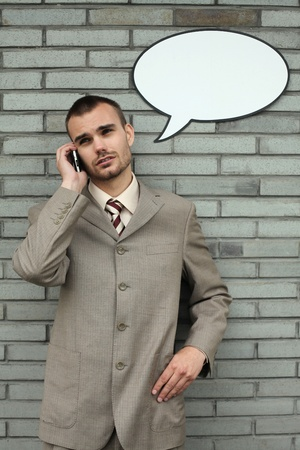 Businessman with speech bubble talking on the phone Stock Photo - 13355306
