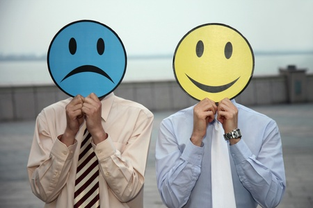 cardboard cutout: Businessmen holding expression masks over their faces