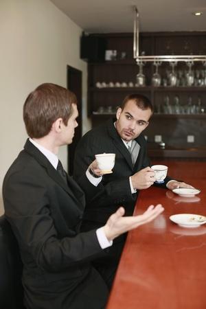 scandinavian descent: Businessmen having tea over discussion