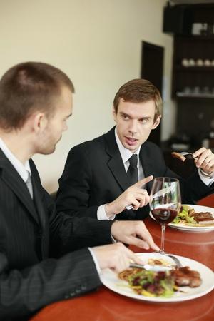 scandinavian descent: Businessmen having lunch at a restaurant