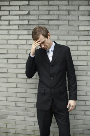 Businessman with hand on forehead photo