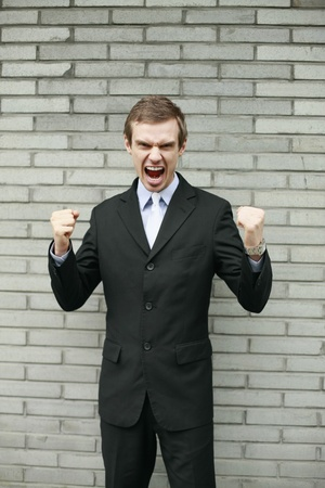 Businessman shouting and clenching fists photo