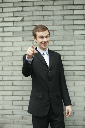 Businessman smiling and pointing finger Stock Photo - 13355139