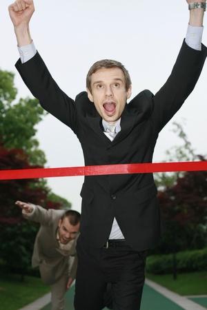 Businessmen racing towards the finish line Stock Photo - 13355073