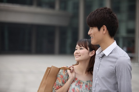 Man and woman smiling while looking away photo