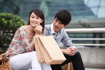 Man and woman resting after shopping photo