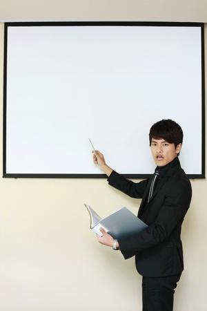 Businessman giving presentation photo