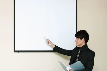 Businessman giving presentation Stock Photo - 13354880