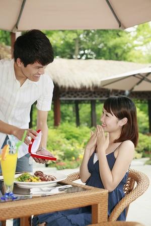 Man giving woman a surprise present photo