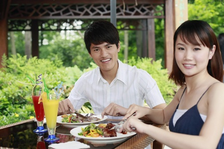 Man and woman enjoying their meal outdoor Stock Photo - 13361457