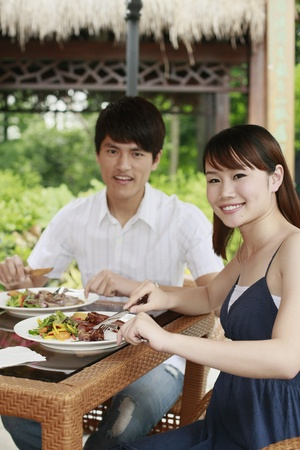 Man and woman enjoying their meal outdoor photo