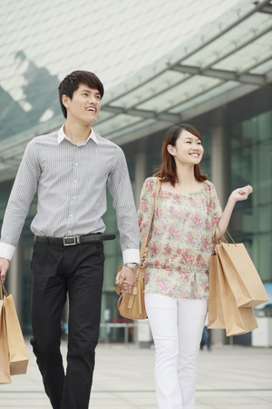 Man and woman with shopping bags Stock Photo - 13361414
