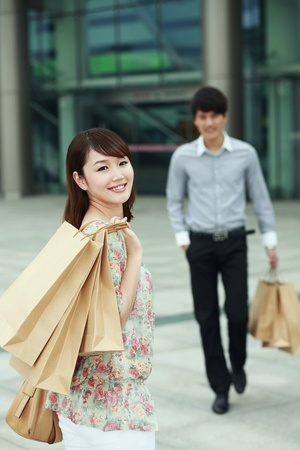 Man and woman with shopping bags photo