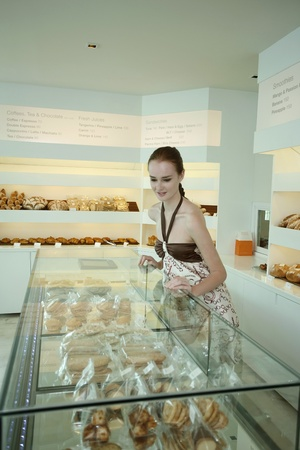 selections: Woman looking at pastry selections in display case Stock Photo
