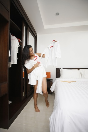 woman closet: Woman choosing clothes from wardrobe