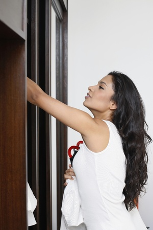 Woman looking through wardrobe Stock Photo