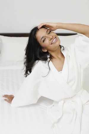Woman in bathrobe sitting on the bed Stock Photo - 13360143