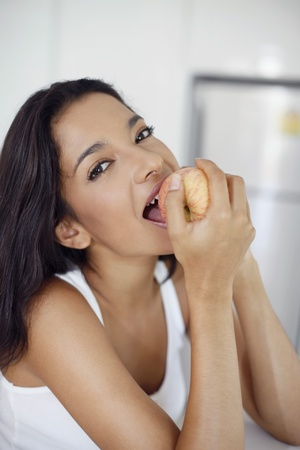 Woman biting on a red apple Stock Photo - 13360450
