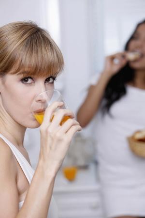 Woman enjoying a glass of orange juice photo