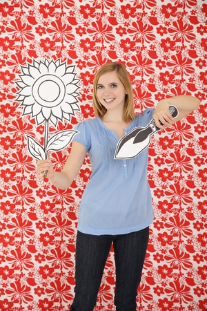 Woman holding cardboard sunflower and a shovel Stock Photo - 13361483