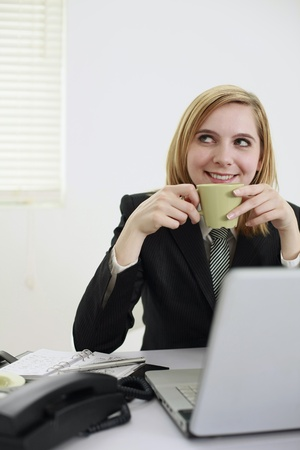 Businesswoman having a cup of coffee photo