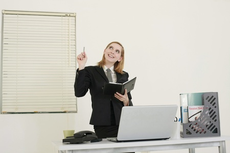 Businesswoman holding organizer smiling photo