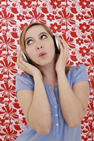 Woman listening to music on headphones photo