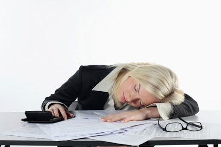 british ethnicity: Businesswoman sleeping at her table Stock Photo