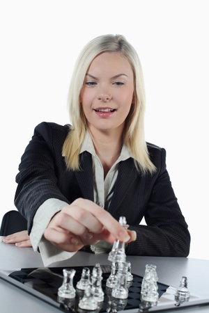Businesswoman playing chess game photo