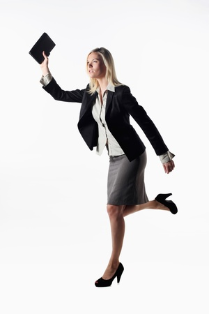 Businesswoman holding organizer and running Stock Photo - 13361464