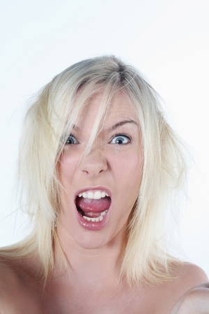 Woman with tousled hair shouting frantically photo