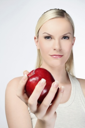 Woman holding red apple photo