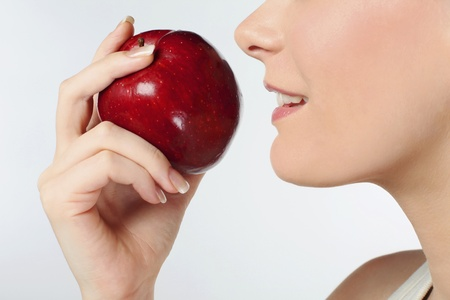 british ethnicity: Woman with red apple Stock Photo
