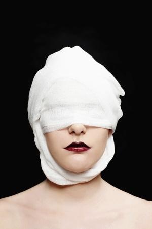 bandaged: Woman with bandaged face