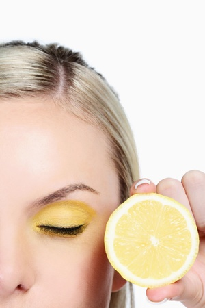 Woman with a slice of lemon photo