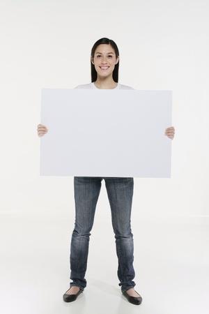 Woman holding white placard photo