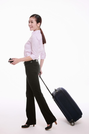 Businesswoman pulling her luggage photo