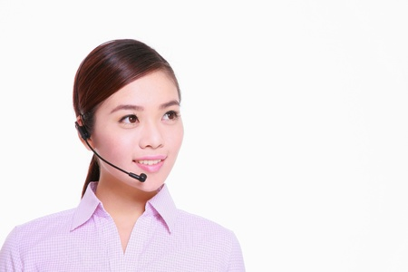 answering call: Businesswoman talking on telephone headset