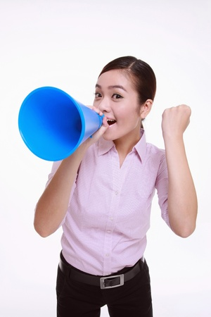 Businesswoman shouting through a megaphone and punching fist in the air Stock Photo - 13366568