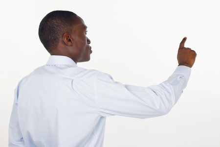Businessman pointing at glass wall photo