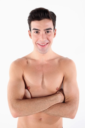 Shirtless man with his arms folded photo