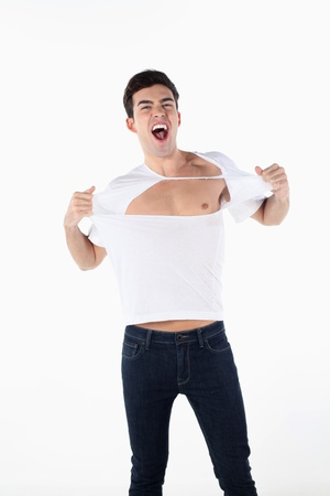 Man tearing open his T-shirt to show bare chest Stock Photo - 13373468