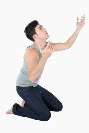 Man kneeling down and looking up