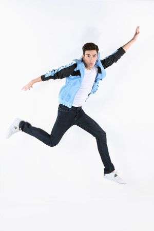 Man in blue jacket jumping Banque d'images