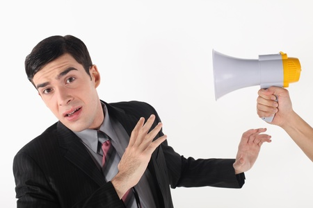 Businessman being shouted at through a megaphone Stock Photo - 13374098