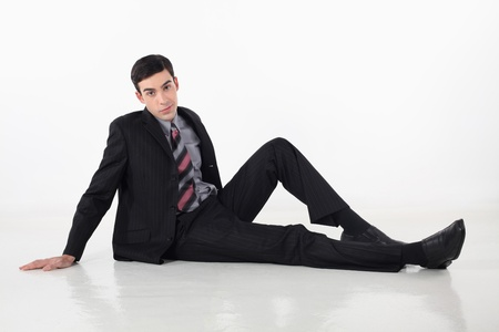 Businessman posing on the floor Stock Photo - 13374373