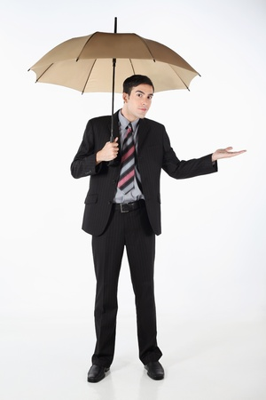 Businessman holding an umbrella and checking the weather photo